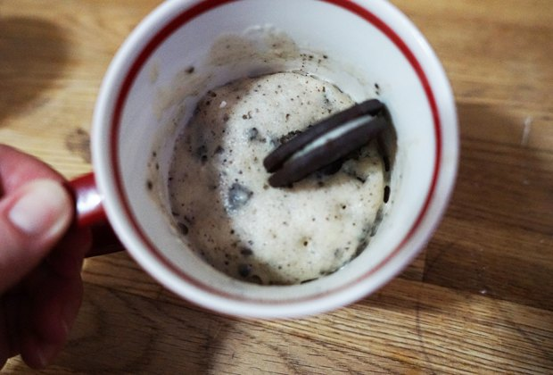 Cookies and Cream Mug Cake topped with an Oreo