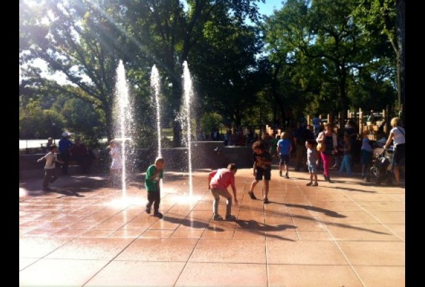 Water sprays shoot up from the ground, kids can control them by pushing a button