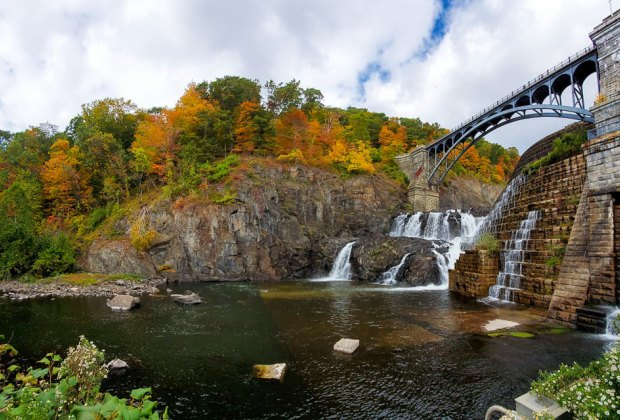 The walkway over Croton Dam framed by fall foliage