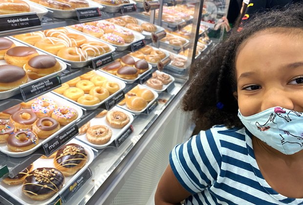 a girl at krispy kreme donuts