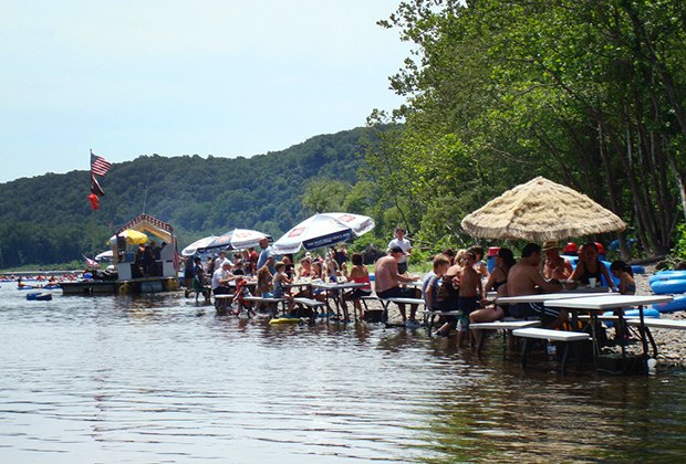 Picnic tables line the Delaware River for a mid-adventure lunch