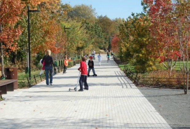 Kids can scooter or bike on the pathway that leads to Freshkills Park