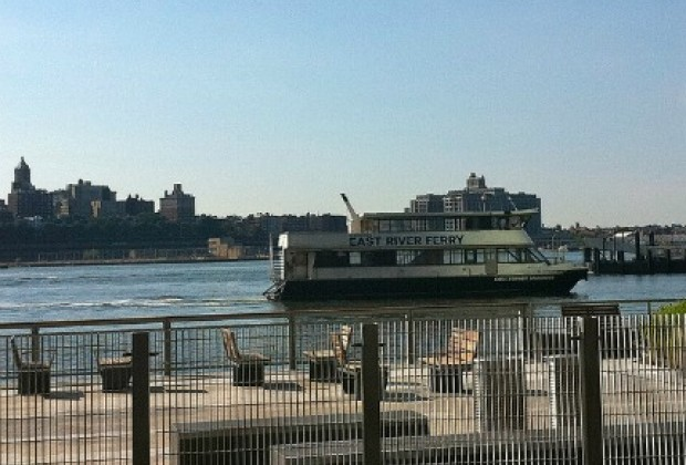 Watch the ferries and boats cruise the East River
