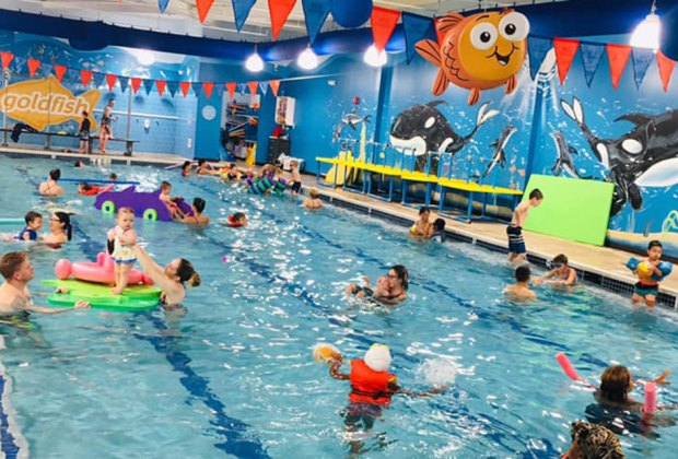 Kids and parents will love the 90-degree pool at Goldfish Swim School, which is open several times a week for family swim.