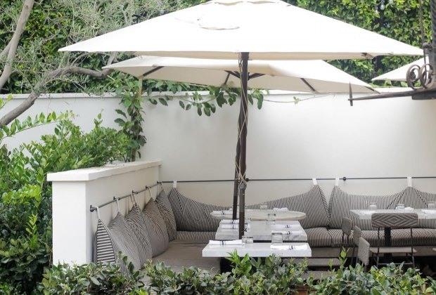 LA Restaurants with Outdoor Seating for Kids: vegan food in an outdoor garden setting at Gracias Madre