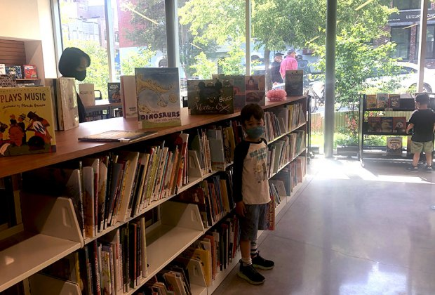 boy in the children's section at the greenpoint library