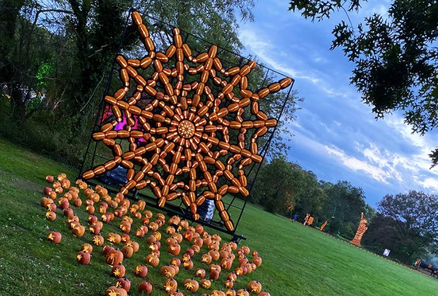 A giant spider web of jack-o'-lanterns greets visitors at The Great Jack O'Lantern Blaze on Long Island