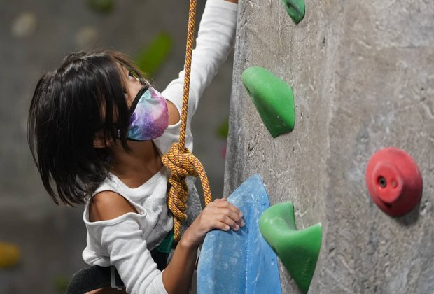 girl rock climbing At The Rock Club Affordable Westchester Summer Camps