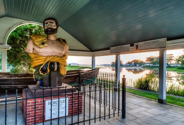 The figurehead of the Greek god Hercules, which once adorned the USS Ohio, now sits in a harborside pavilion in Stony Brook. Photo courtesy of the Ward Melville Heritage Organization