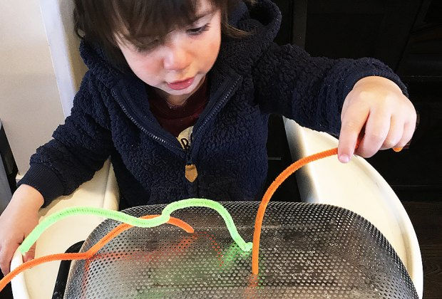 Turn a Highchair into a Baby Activity Center: A great pincer grasp activity.