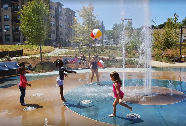 In the warmer months cool down in the splash pad at Historic Fourth Ward Park and Playground.