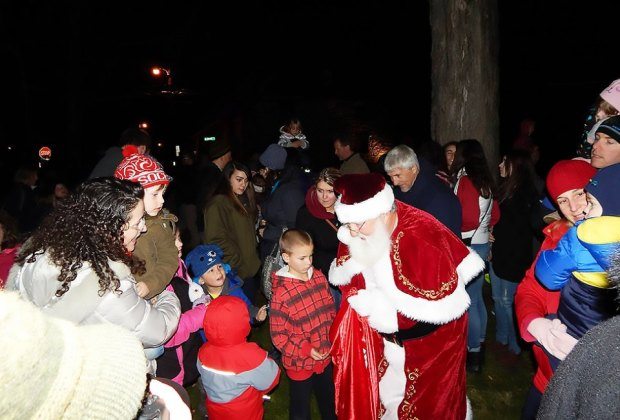 Santa greets visitors at Holiday on Huguenot Street in New Paltz. Courtesy of the event