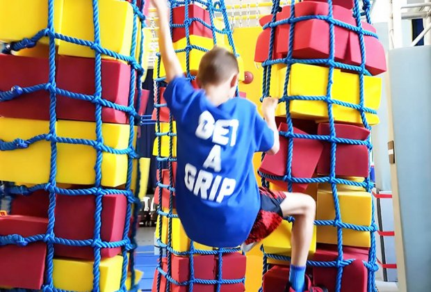 Hudson Play Sports Camp Boy climbing ropes