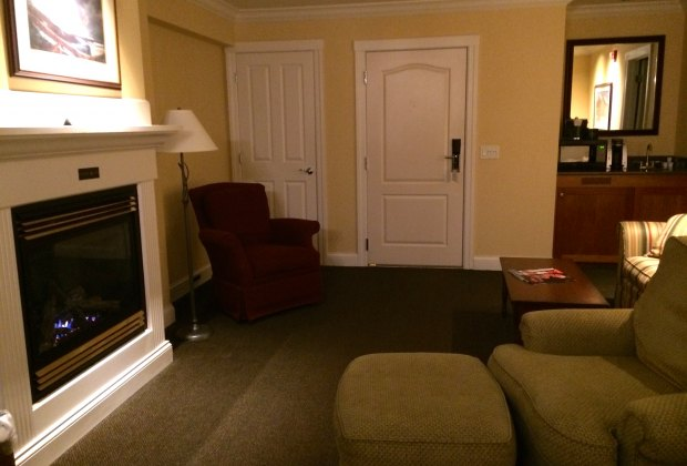 A one bedroom suite offers a cozy living room with a fireplace