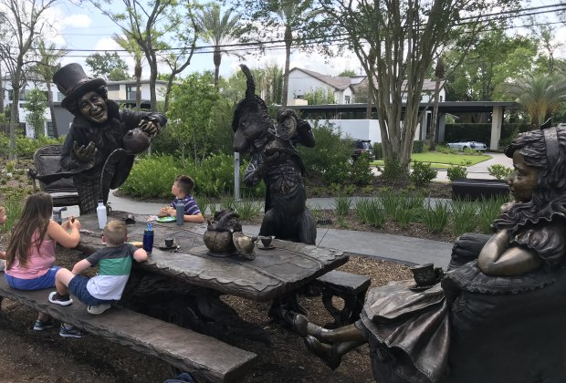 """Picnicking at the """"Move One Place On"""" sculpture in Evelyn's Park."""