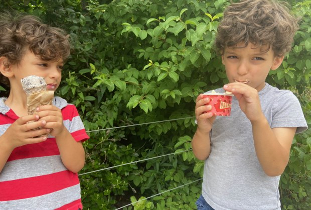 Two boys eating ice cream