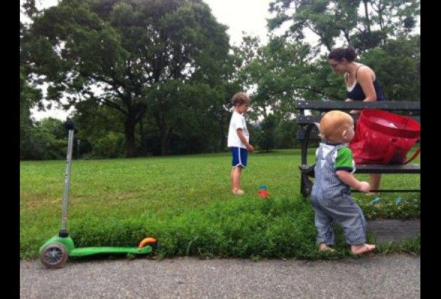 Families enjoy the peaceful main lawn at Isham Park