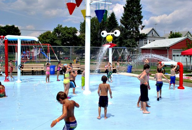 The sprinkler park  at Jewell Street playground has dumping buckets, an arc of sprinklers, a face that spews water, and more!
