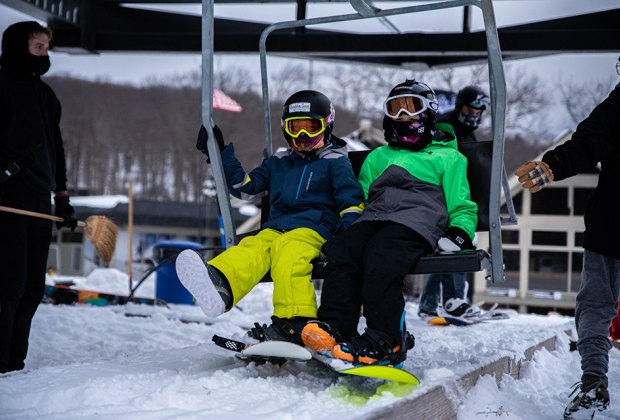 Big Boulder/Jack Frost snowboarders taking the chair lift Best Snowboarding NYC