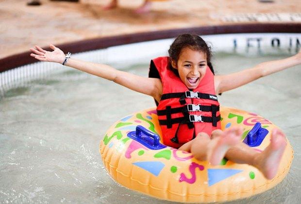 girl in floating in inner tube