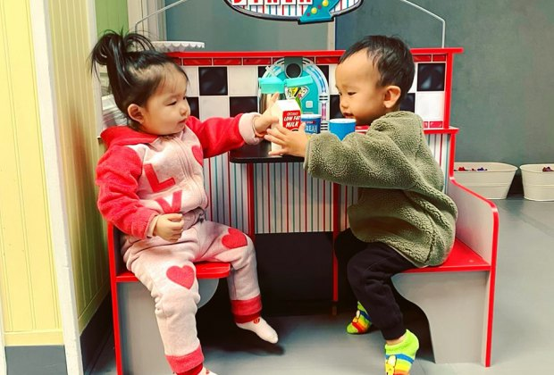 Kids Play World Kids boy and girl sharing a pretend meal Queens play spaces