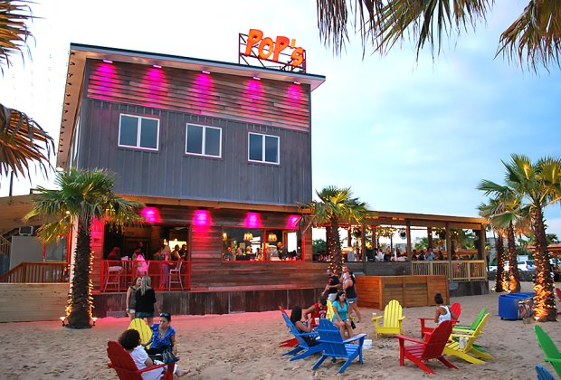 Enjoy the tropical island atmosphere at Pop's Seafood Shack and Grill in Island Park.