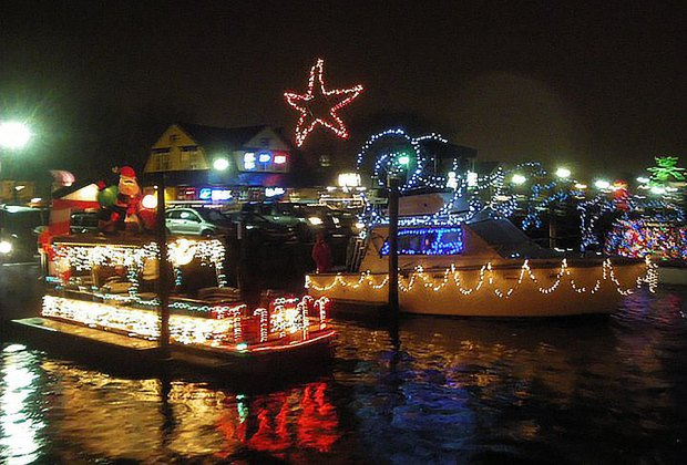 Sea vessels light up the harbor at the Freeport Boat Parade. Photo courtesy of the event