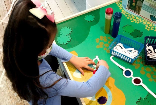 Girl playing with arts and crafts at the Long Island Explorium What's open Now Long Island