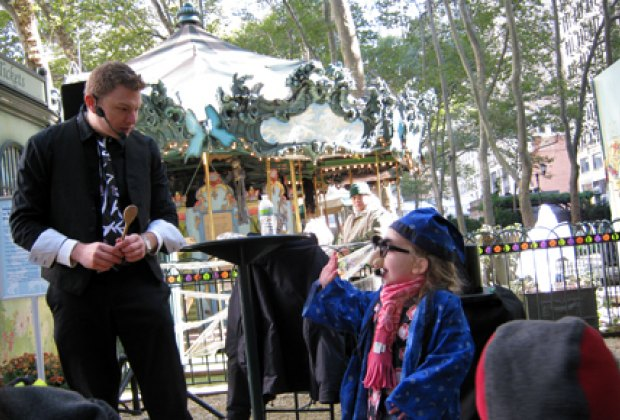 Watching a magician in Bryant Park