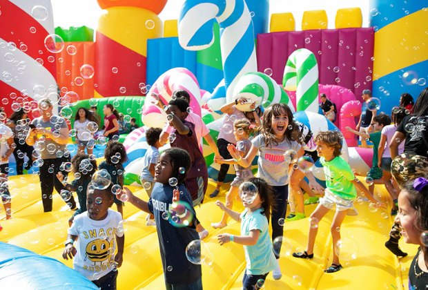 Crews of kids in bounce house with bubbles