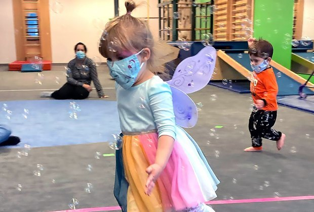 Kids play with bubbles at My Gym Westchester Open Now