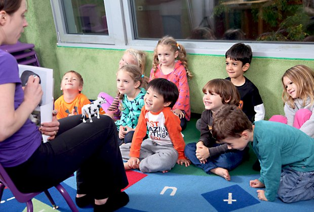 Preschoolers gather for storytime at New York Preschool. Photo courtesy of the school