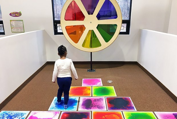 Girl explores the color wheel at Imagin That!