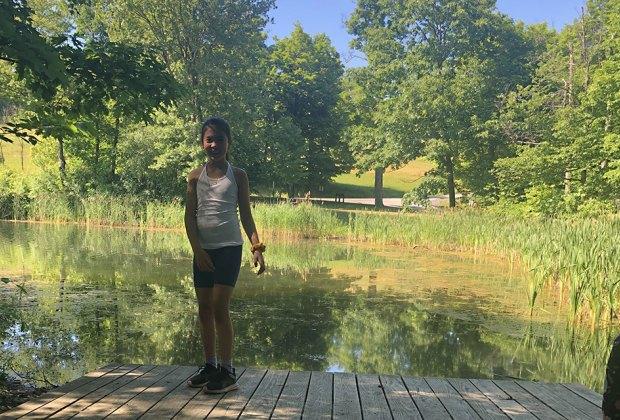 Girl on a small bridge over pond at Olana house
