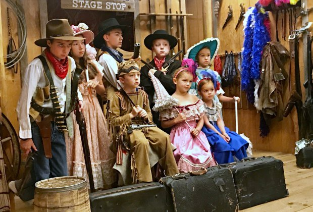 Kids play dress up at an old-time photo studio in Jackson Hole, Wyoming