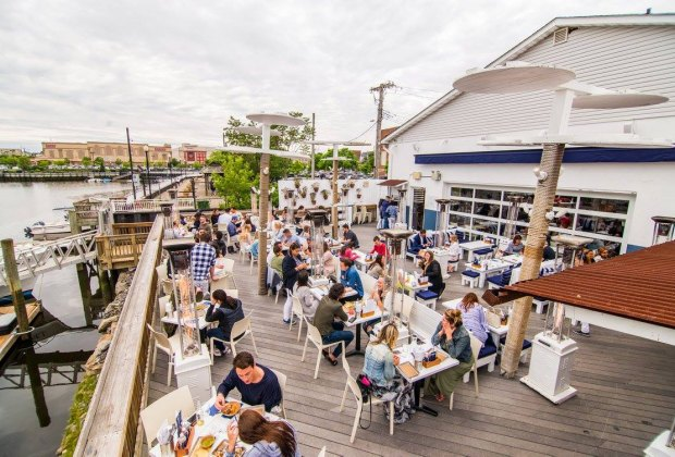 Enjoy outdoor family dining with water views at Bartaco in Port Chester.