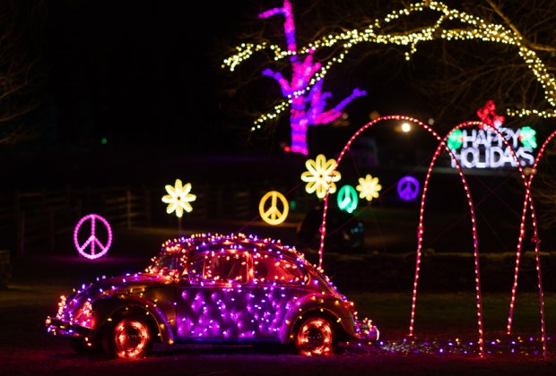 VW Bug is adorned with lights at Bethel Woods' Peace, Love & Lights holiday lights display