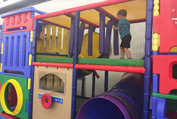 My 3 Year Old Having Fun On The Upper Level Of The Tyke Spot Structure.