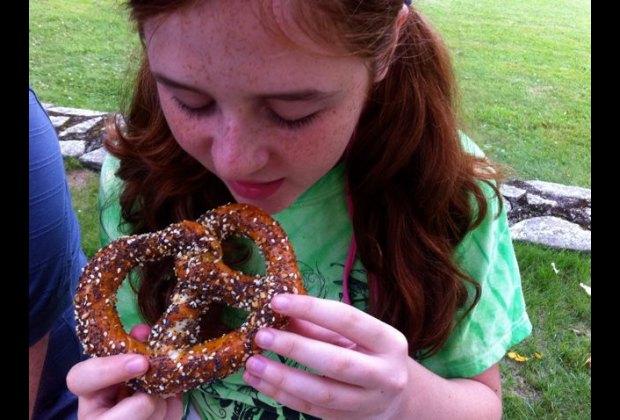 Enjoying an everything pretzel from Callie's Pretzel Factory