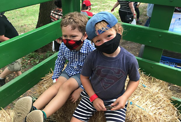 Two boys on a hayride at Queens County Farm Museum
