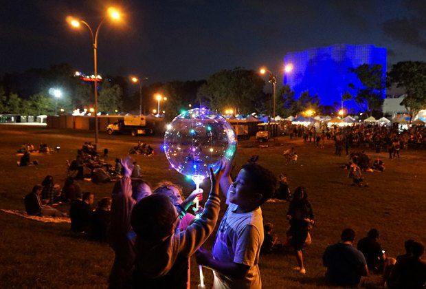 Kids with giant bubbles at the Queens Night Market