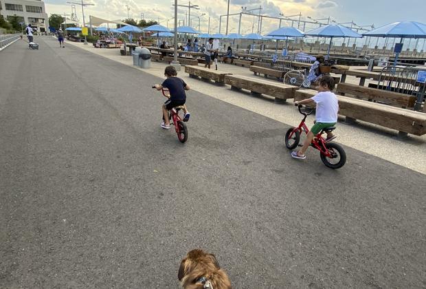 two boys ride bikes