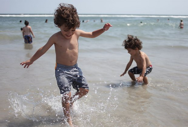 Kids in the water at Jacob Riis Beach