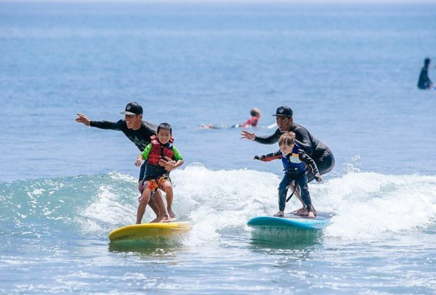 the Rockaway Hotel kids surfing with instructors