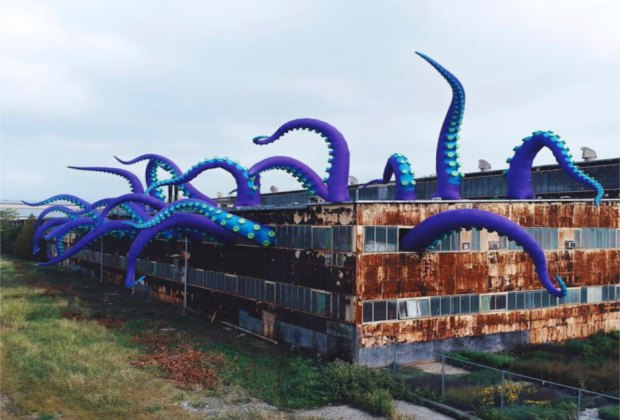 Sea monster tentacles erupt from an abandoned warehouse in the Navy Yard.