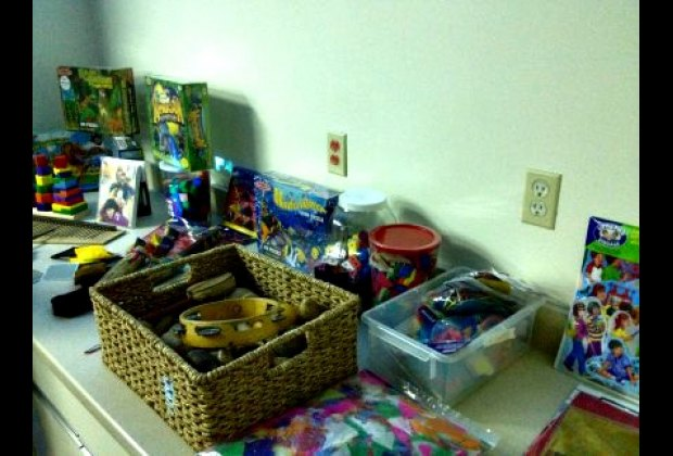 Bins chock-ful of sensory toys, social situation books and instruments