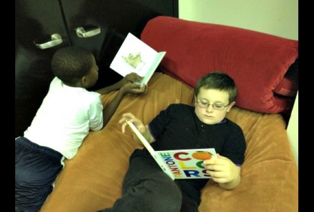Jake and his new pal reading on a giant beanbag