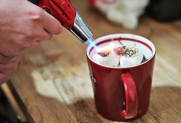 Kitchen torch toasts marshmallows atop at mug cake