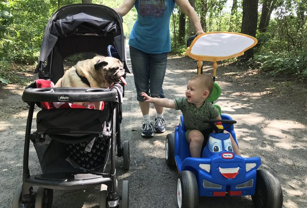 mom, dog in stroller and boy at Belmont Lake State Park