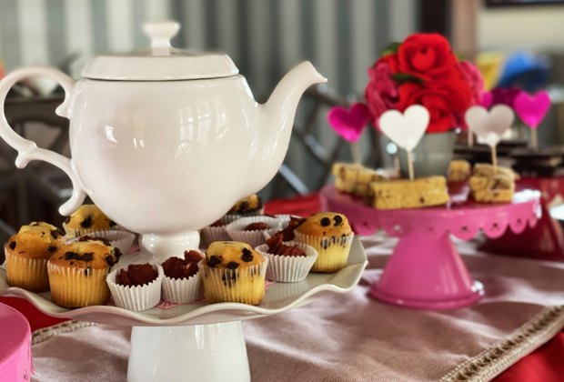 Set the tea table with a favorite tea set and bite-sized treats.